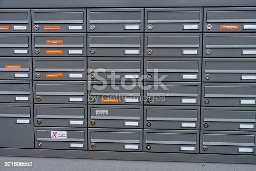 istock Mailboxes in an apartment building in a new building house 921808552