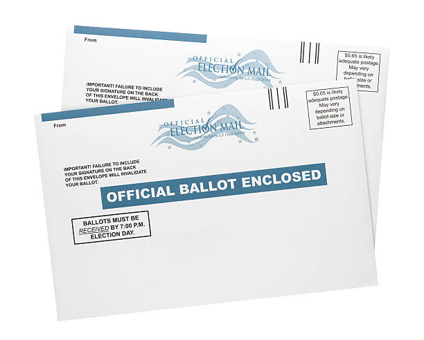 """Mail-in Ballots """"Colorado Springs, Colorado, USA - September 20, 2012: Two official US mail-in ballot envelopes shot in the studio and isolated on a white background. Mail-in ballots enable a person to vote through the mail instead of in person at a polling place."""" absentee stock pictures, royalty-free photos & images"""