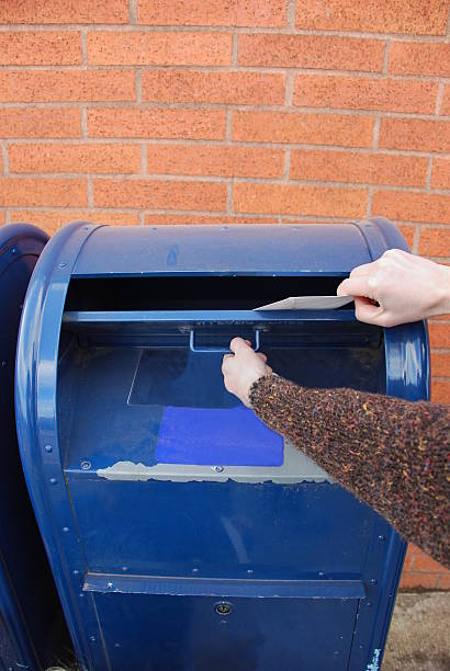 Mailing an envelope stock photo