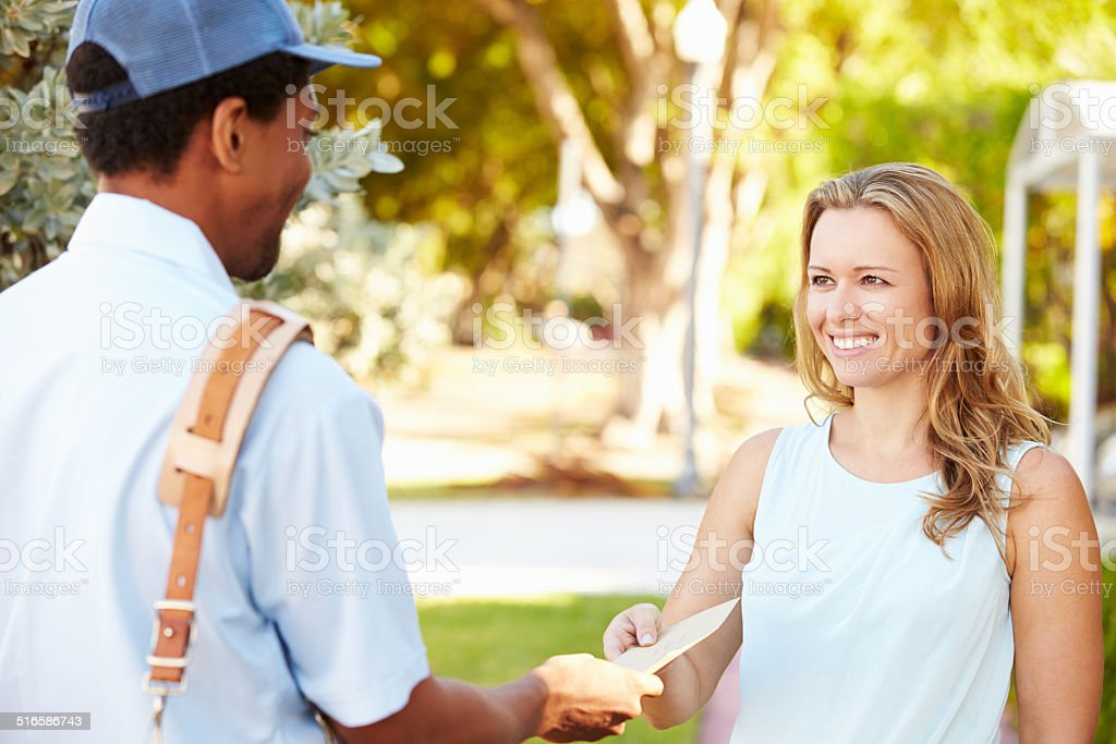 Mailman Delivering Letters To Woman stock photo