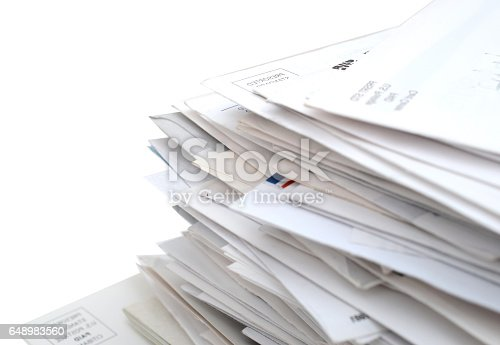 istock Mails and bills on stacking closeup 648983560