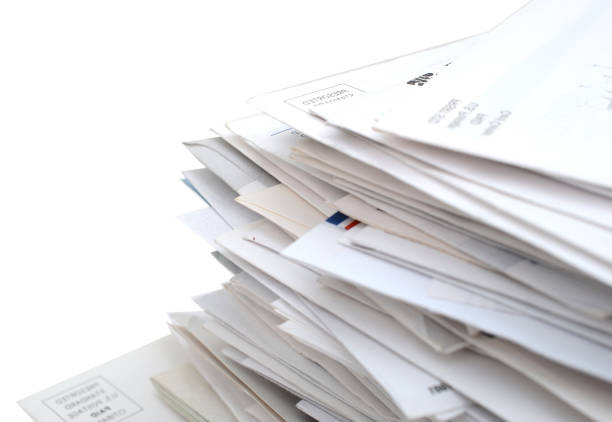 mails and bills on stacking closeup - mail stock photos and pictures