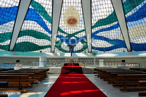 Brasília, Federal District, Brazil: altar and glass roof over white concrete pillars of the Cathedral of Brasília - architecture by Oscar Niemeyer Soares - Metropolitan Cathedral of Our Lady Aparecida - dedicated to the Blessed Virgin Mary as Our Lady of Aparecida.