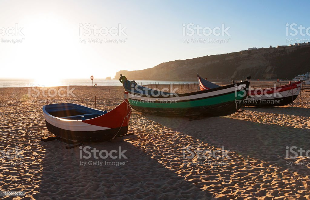 Main beach in Nazare with Traditional boats, Portugal stock photo
