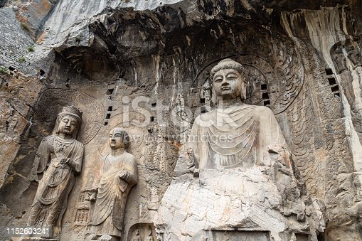 Main Buddha statue in Fengxiangsi Cave, the main one in the Longmen Grottoes in Luoyang, Henan, China. Longmen is one of the 3 major Buddhist caves of China, and a World heritage Site.