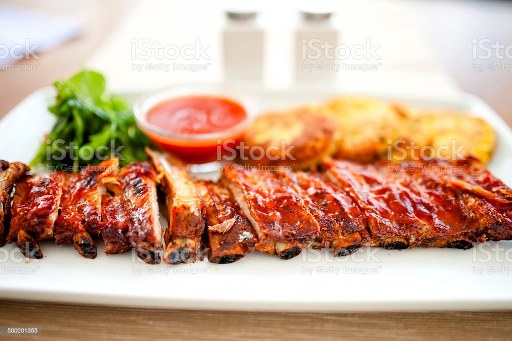 main dish - pork ribs and barbeque sauce with parsley stock photo