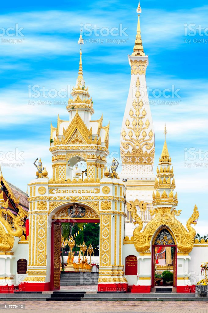 Main doorway to Buddhist temple of Wat Phra That Phanom houses famous stupa containing Buddha's breast bone in Nakhon Phanom Province, northeastern Thailand. Thai texts written above the archway is the name of the temple. stock photo