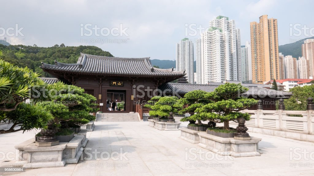 Main entrance of Chi Lin Nunnery in Kowloon, Hong Kong. Sign above door reads 'Shanmen' in Chinese characters. Shanmen is the name of the most important gate of a Chinese Buddhist temple. stock photo