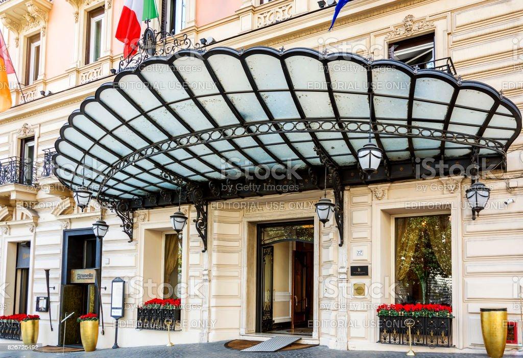 main entrance of the Regina Hotel Baglioni in Rome stock photo
