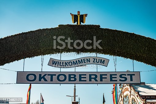 Munich, Germany - October 1, 2019: Main Entrance Sign with the Münchner Kindl as Munich's Coat-of-Arms at Oktoberfest on a sunny morning in october