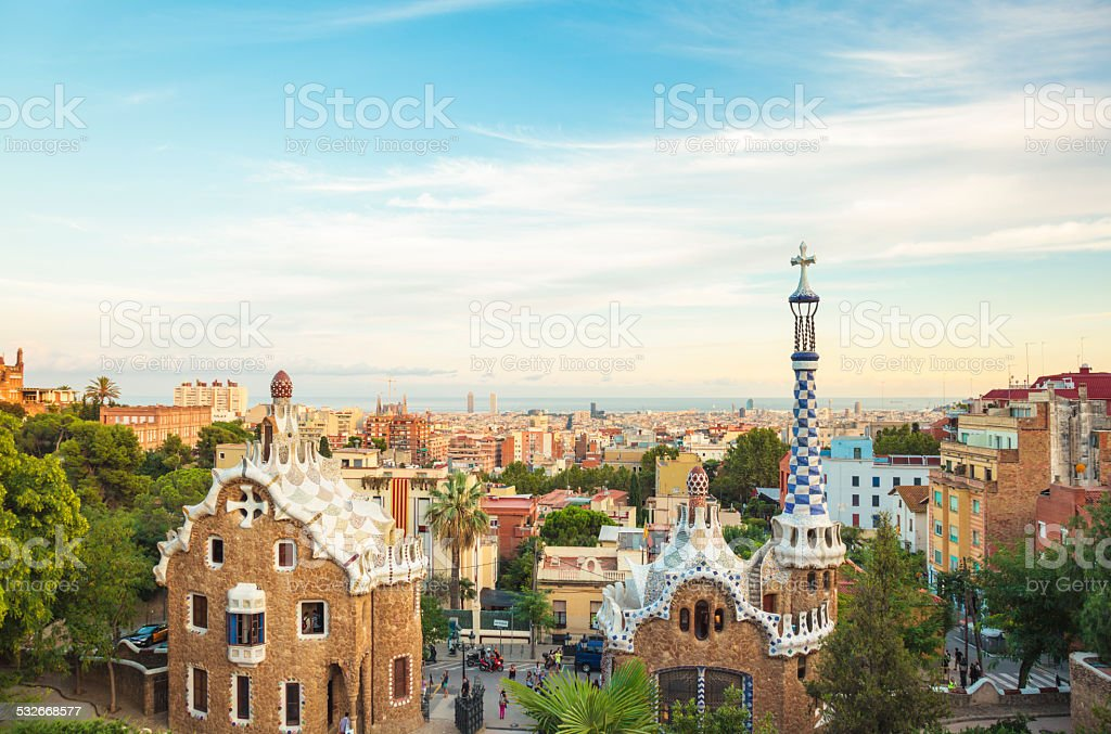 Main entrance to Gaudi's Parc Guell and skyline of Barcelona stock photo