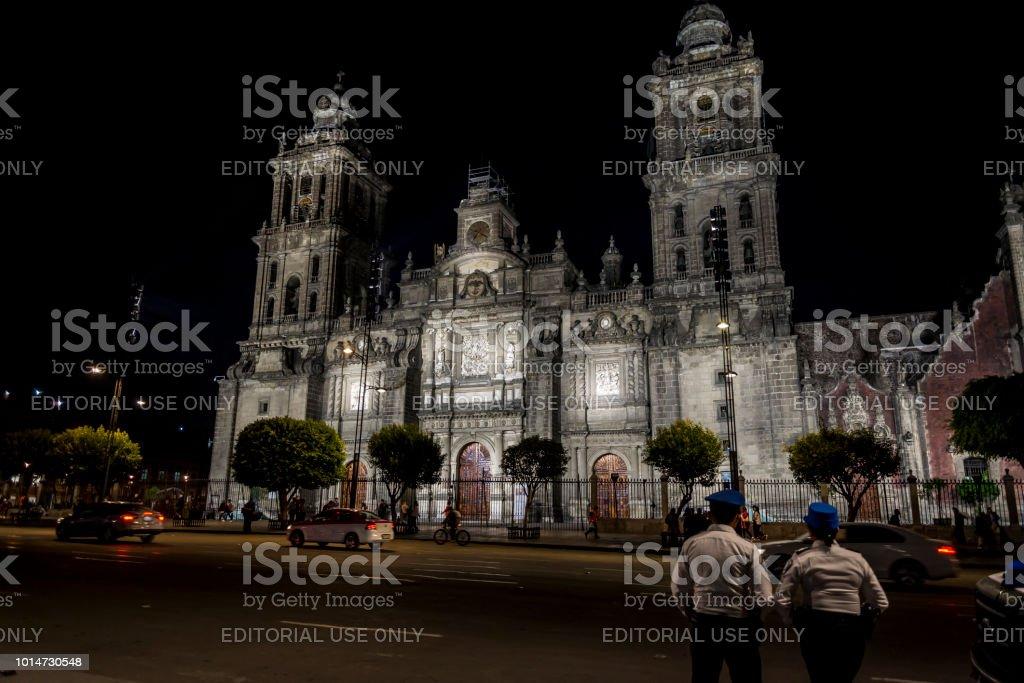 Main facade of the Mexico City Metropolitan Cathedral at night,...