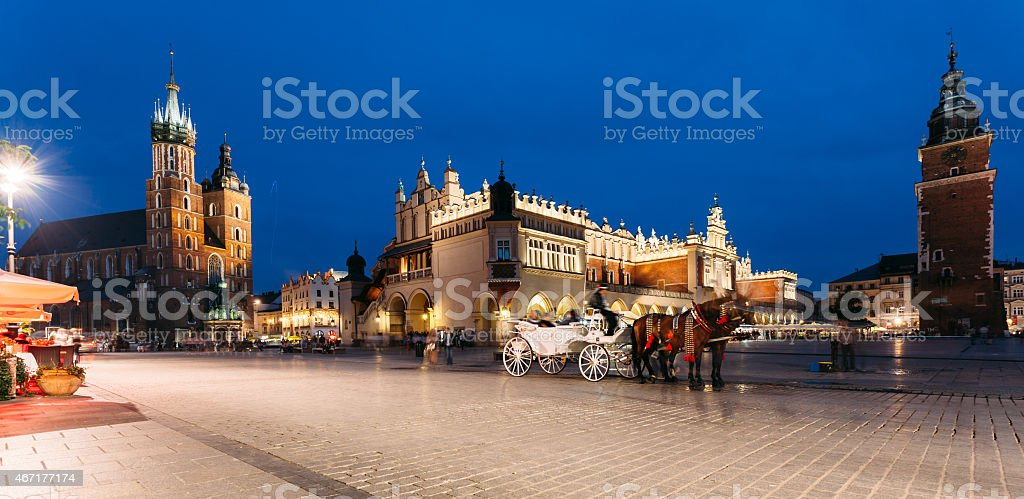 Main Market square of Krakow at a summer evening stock photo