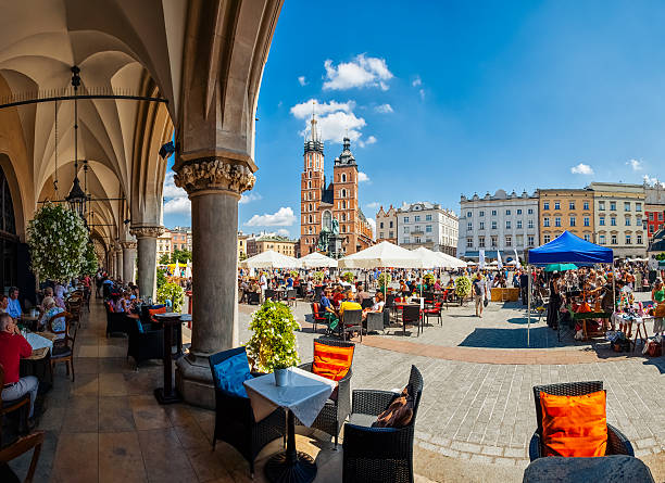 main market square of krakow - poland stock photos and pictures