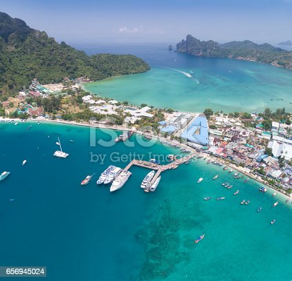 Aerial view of Long-Tail Boats and Ferries at the Main Pier Ao Tonsai on Phi Phi Island, Thailand. Converted from RAW.
