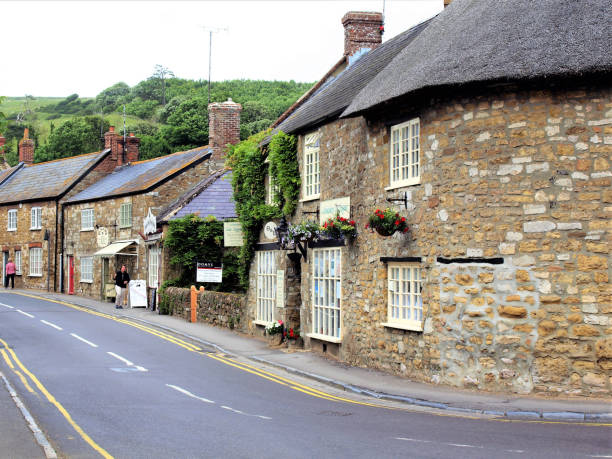Main road, Abbotsbury, Dorset, UK. stock photo