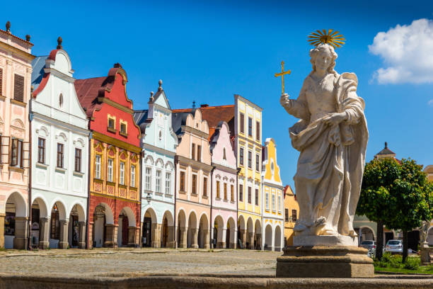 Main square of Telc city, a UNESCO World Heritage Site, on a sunny day with blue sky and clouds, South Moravia, Czech Republic. Main square of Telc city, a UNESCO World Heritage Site, on a sunny day with blue sky and clouds, South Moravia, Czech Republic. moravia stock pictures, royalty-free photos & images