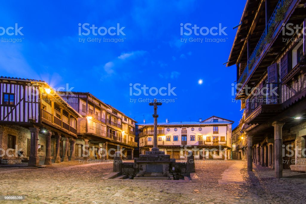 Main Square with a commemorative cross at sunrise  at snowy day stock photo