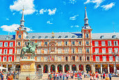 Main Square (Plaza Mayor) with tourists and people, is a central plaza in the city of Madrid, Spain.