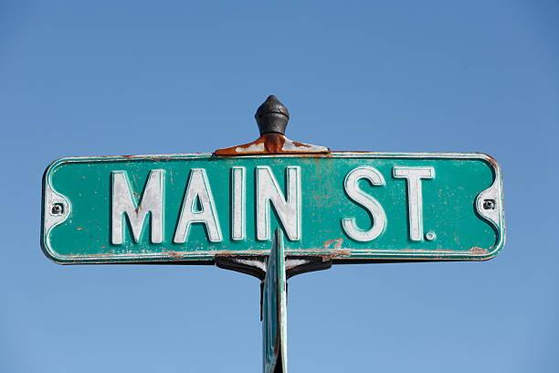 main street. - straßenschild stock-fotos und bilder