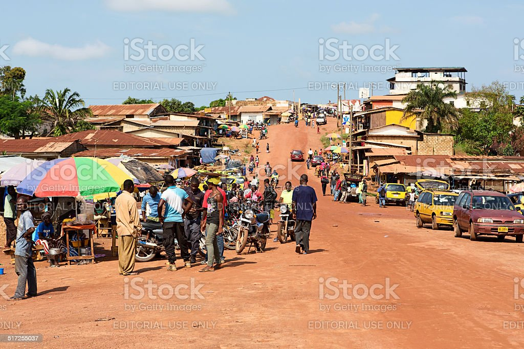 Main street and urban marketplace in Gbarnga in Liberia. stock photo