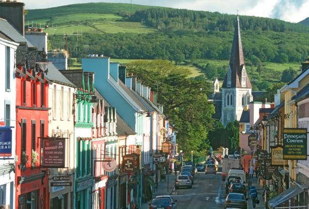 main street in irish town - republic of ireland stock pictures, royalty-free photos & images