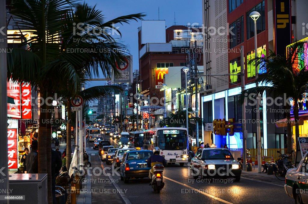 Main street, Naha, Okinawa Naha City, Okinawa, Japan - November 25, 2013: Kokusai dori, the main street in Naha City, Okinawa, Japan. The Japanese island Okinawa is one of Japan´s southernmost islands. The climate at Okinawa is subtropical and the beaches are considered among the world´s most beautiful. 2015 Stock Photo