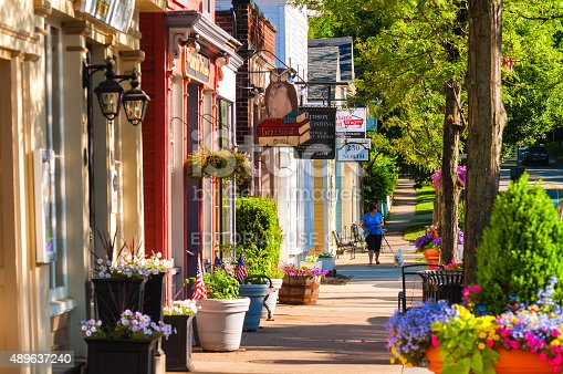 Hudson, OH, USA - June 14, 2014: Quaint shops and businesses dating back more than a century line Hudson's Main Street looking north.