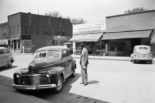 Main street of small rural town in 1941. Keota, Iowa, USA.