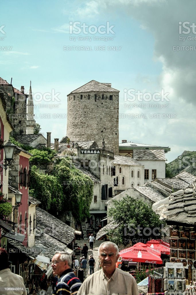 Main street of the Mostar Bazaar in the old town with pedestrians passing by. Mostar is one of the main landmarks of Herzegovina and a touristic attraction stock photo