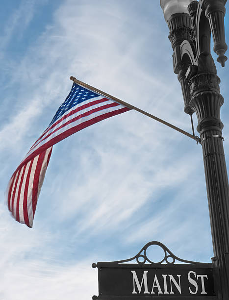 main street sign with american flag - kellyjhall stock pictures, royalty-free photos & images