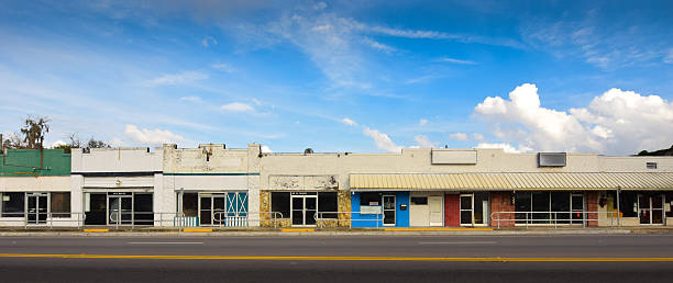 Main Street Stores in Small Town America A row of empty, old retail storefronts in Williston, Florida. derelict stock pictures, royalty-free photos & images