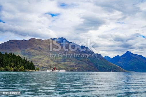 Tourists are enjoying the lake view by tourboat at the Main Town Pier of Queenstown New Zealand, South Island.