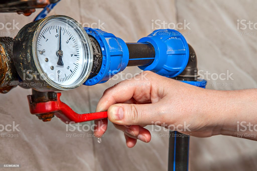 Main Water Shutoff Valve, Hand Shutting Off lever controls supply. stock photo
