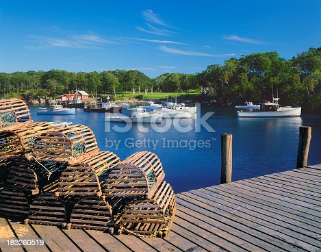 Wooden lobster traps and fishing boats of New Harbor, Maine