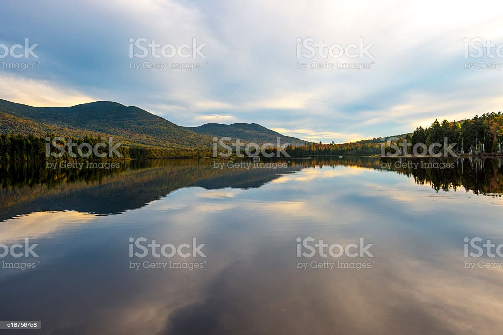 Maine Lake Highlands Region with Sky Reflection and Forest Mountains stock photo