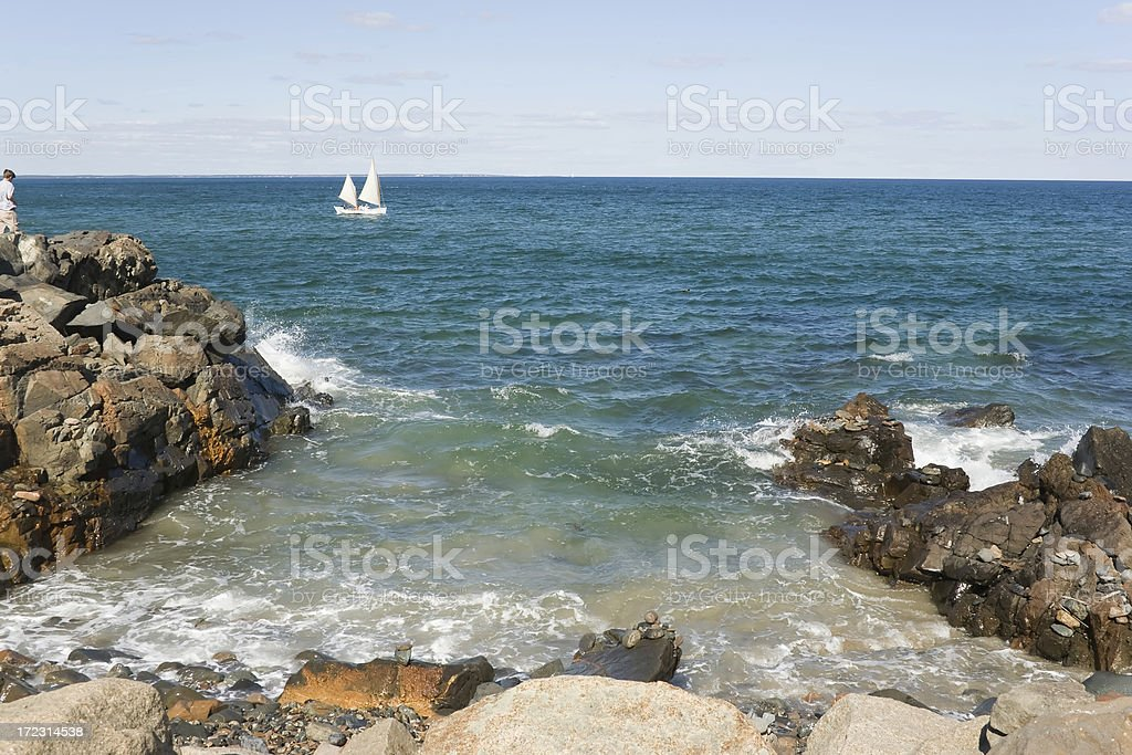 Maine Shoreline with Sailboat royalty-free stock photo