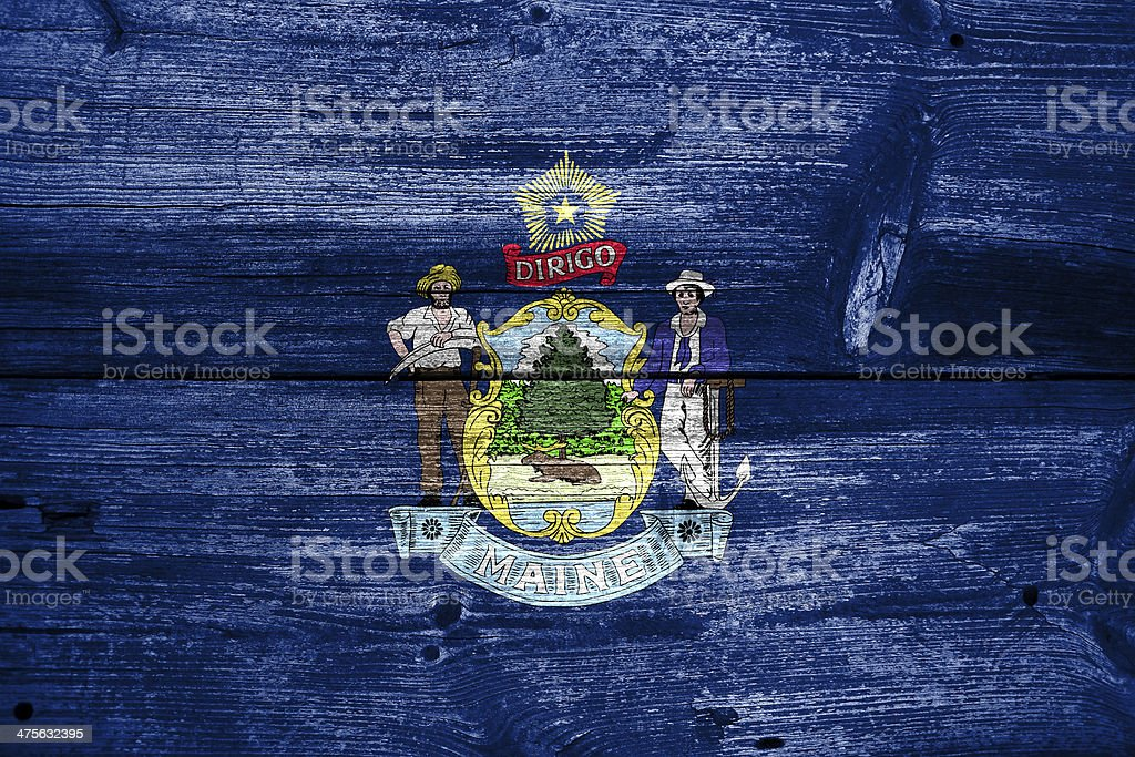 Maine State Flag painted on old wood plank texture royalty-free stock photo