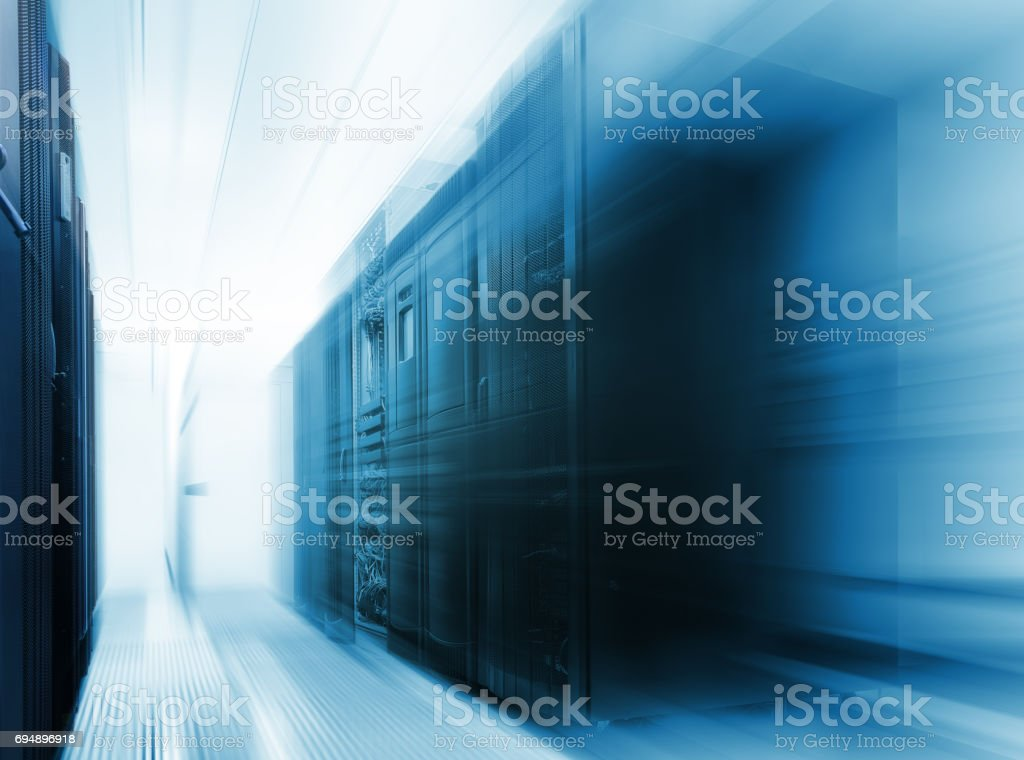 mainframe clusters in modern data center with blur and motion Blue tone stock photo