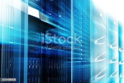 istock mainframes cluster  with control terminal in data center. motion blur 525498928