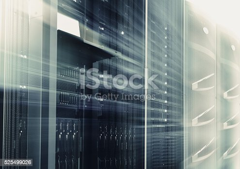 istock mainframes cluster  with control terminal in data center. motion blur 525499026
