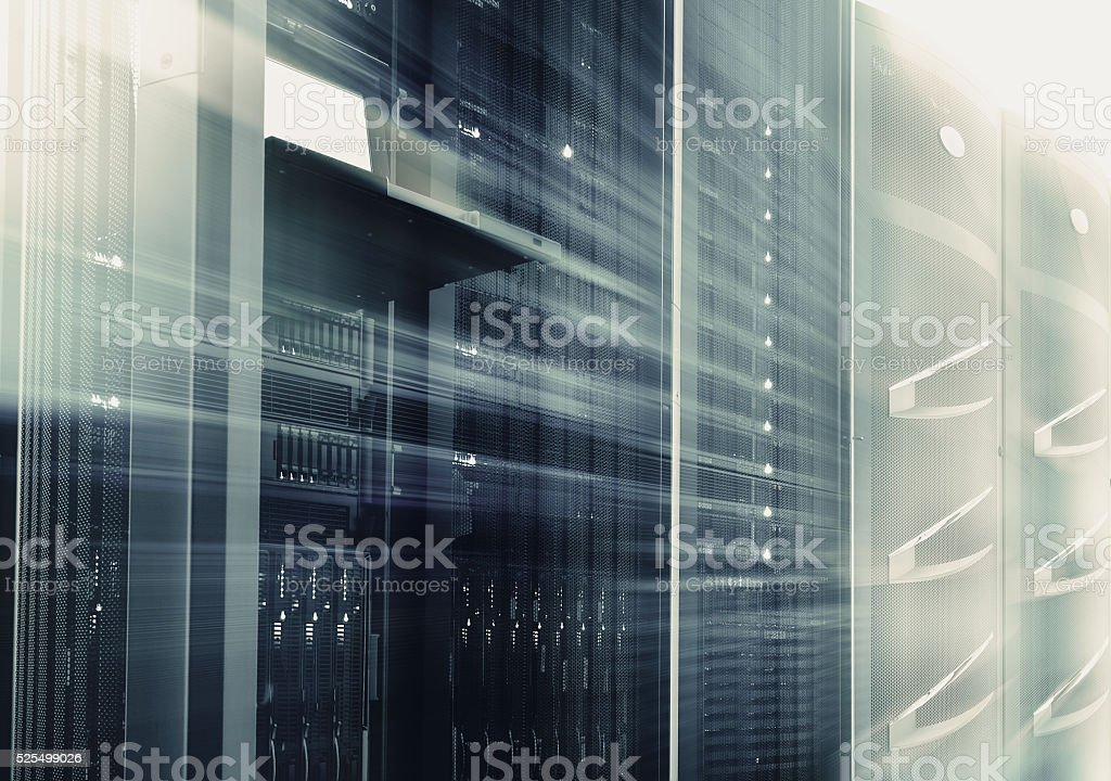 mainframes cluster  with control terminal in data center. motion blur stock photo