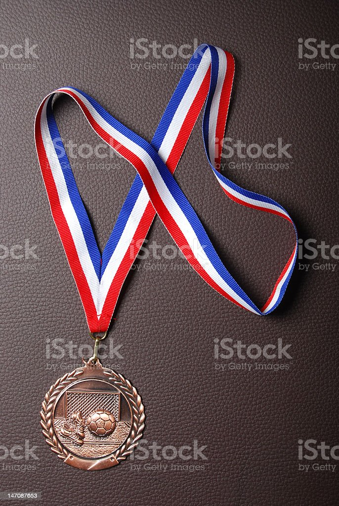 Maintaining a soccer medal royalty-free stock photo
