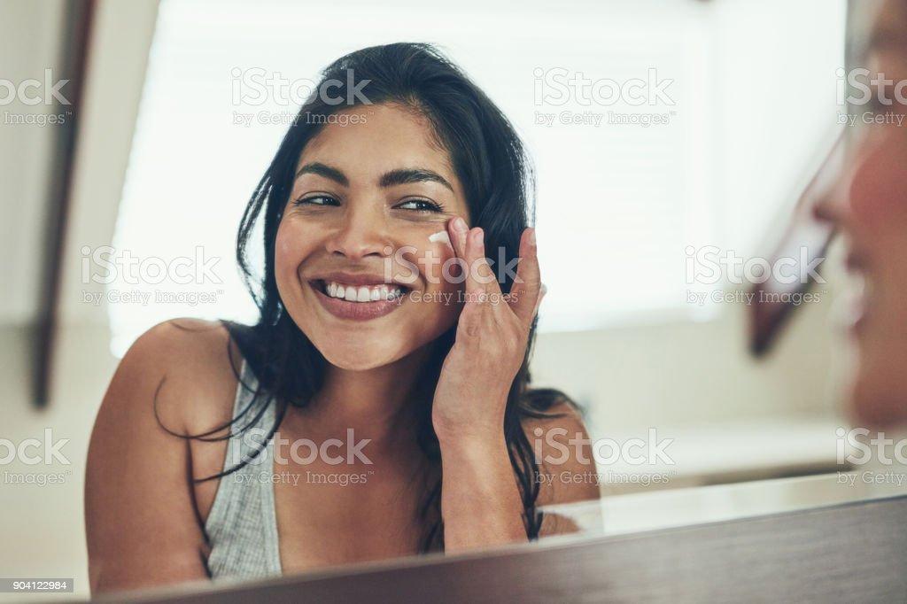 Maintaining her radiant skin stock photo