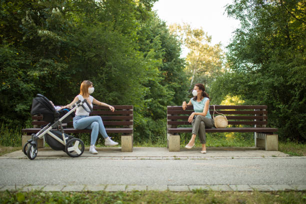 Maintaining social distance in a public place stock photo