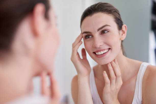 Maintaining the health of her skin stock photo