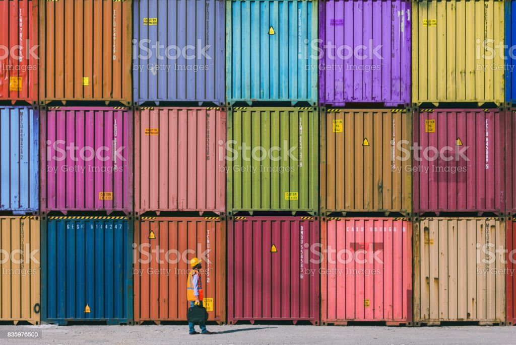 Maintanence worker working with cargo containers stock photo