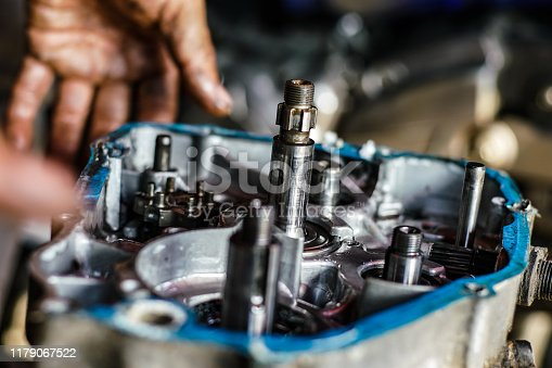 1073743202 istock photo Maintenance and fix repair gear engine hand of technician close up 1179067522