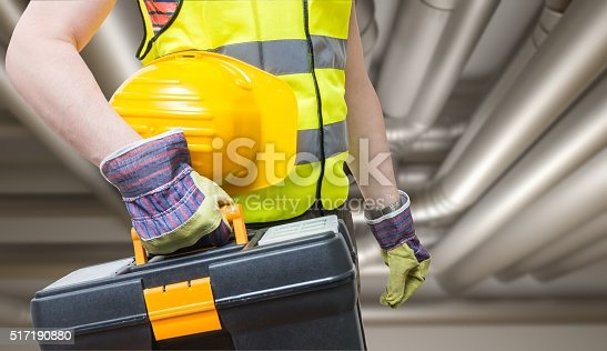 895571294 istock photo Maintenance concept. Technician and pipes in background. 517190880