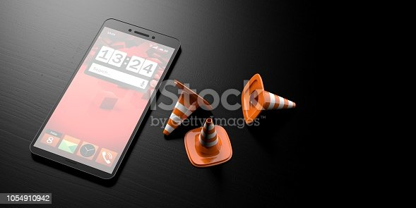 istock Maintenance concept.Traffic cones next to a smartphone. Black wooden background, banner, copy space. 3d illustration 1054910942